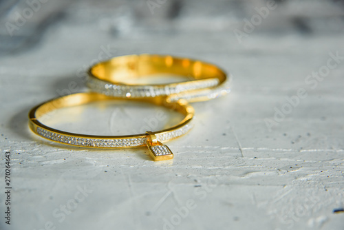 Gold bracelets with precious stones Fototapeta