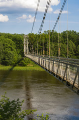 Side view on the suspension pedestrian bridge through the Neman River in the city Mosty, Republic of Belarus