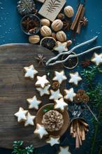 Overhead View Of Cinnamon Stars, Star Anise, Cinnamon Sticks On Table