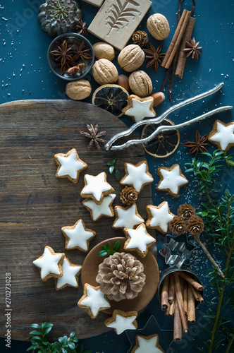 Cinnamon stars, star anise, cinnamon sticks, nutcracker and pine cones