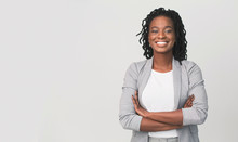 Successful African Businesswoman With Arms Crossed, Grey Background