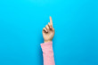 canvas print picture - Person pointing at something on a blue background