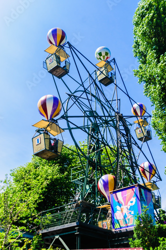 Poster Attraction parc Balloon ferris wheel ride at the Tivoli Garden amusement park and pleasure garden in Copenhagen, Denmark.