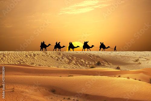 Keuken foto achterwand Kameel Desert adventure with camels ride and travellers on sand dunes