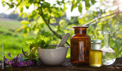 Poster Pharmacie Essential oil, with flowers and natural herbs.
