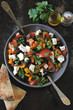 Fresh salad with vegetables, parsley and white cheese.