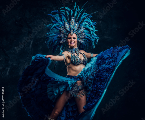 Foto Festive smiling can can dancer in blue costume is showing her perfomance