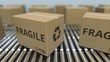 Carton boxes with FRAGILE text move on roller conveyor. Loopable 3D animation