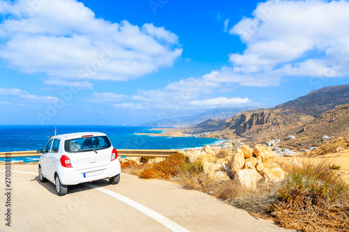 Foto auf Gartenposter Santorini Rental car parked on road side during coastal drive around Karpathos island, Greece