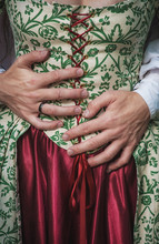 Mans Hands Holding Woman In Medieval Dress