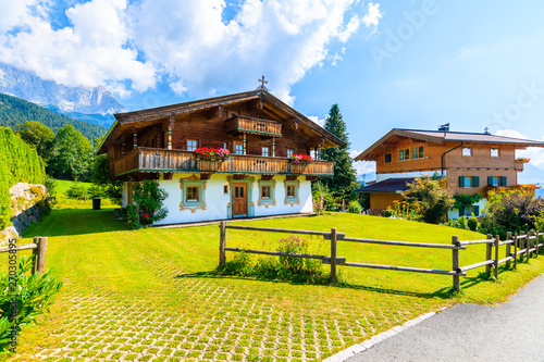 Foto auf AluDibond Himmelblau Traditional alpine houses in village of Going am Wilden Kaiser on beautiful sunny summer day, Tirol, Austria