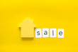 Sale copy with house figure on yellow background top view