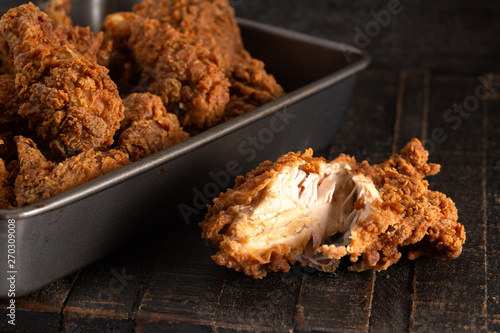 Batch of Crispy Homemade Fried Chicken on a Rustic Wooden Table Fototapet