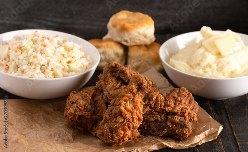 Fototapeta Meal of Fried Chicken Mashed Potatoes Coleslaw and Buttermilk Biscuits obraz