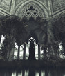 canvas print picture - Ghost woman standing in gothic carved stone building,3d rendering