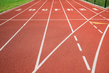 Red Running Track, Track And Field Or Athletics Track Start Line With Lane Numbers