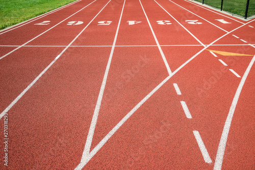 Red running track, track and field or athletics track start line with lane numbe Canvas Print