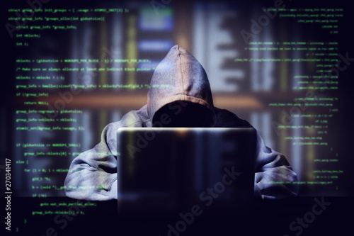 hacker working on a computer code with laptop, double