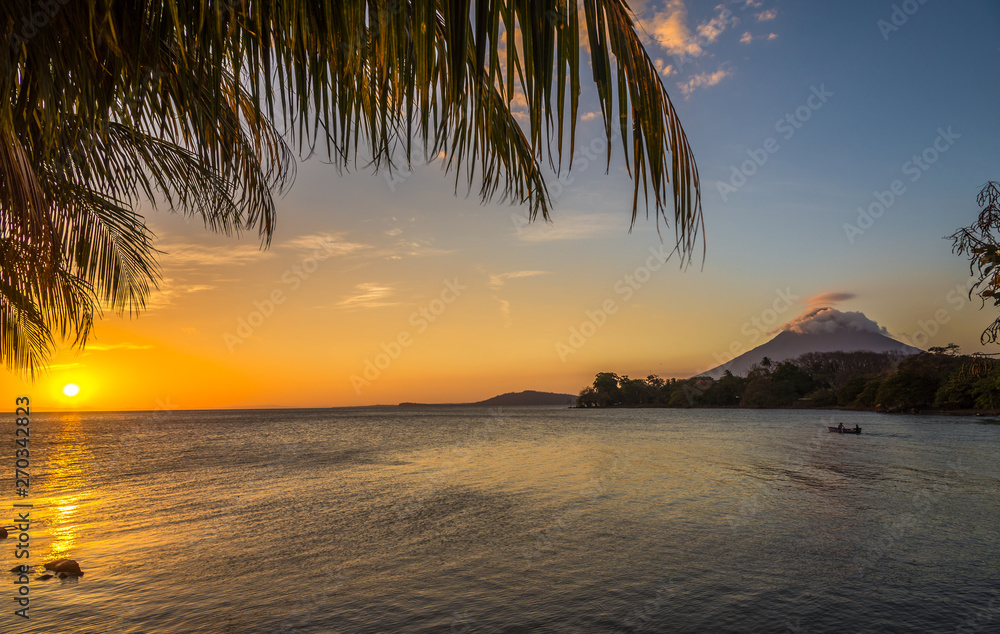 Fototapeta View at the sunset with Conception Volcano at the Nicaragua lake in Ometepe Island - Nicaragua