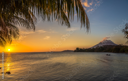 View at the sunset with Conception Volcano at the Nicaragua lake in Ometepe Isla Wallpaper Mural