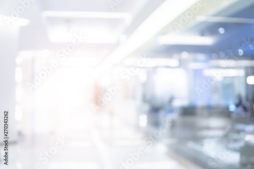 Obraz Abstract blur shopping mall corridor. Blurred retail and hall interior in department store. Defocused bokeh effect background or backdrop for business concept. - fototapety do salonu