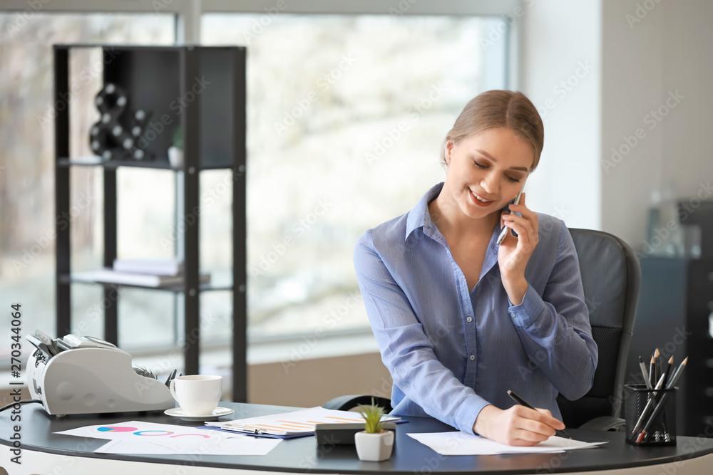 Fototapety, obrazy: Female accountant working in office
