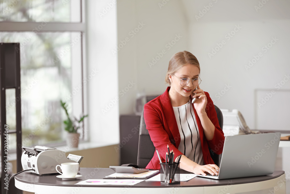 Fototapeta Female accountant working in office