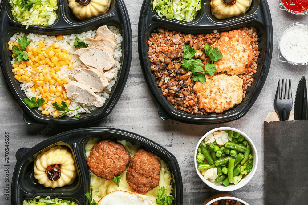 Fototapety, obrazy: Containers with delicious food on grey background