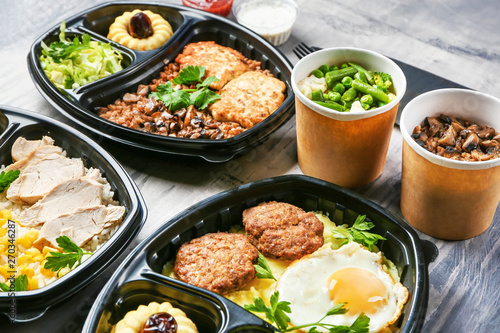 Fotografie, Obraz Containers with delicious food on grey background