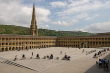 Halifax West Yorkshire UK, 10th May 2019: Photo Of The Famous Piece Hall In The Blackledge Area Of Halifax, Showing The Historic Stone Build Building, Taken On A Part Cloudy Sunny Day.