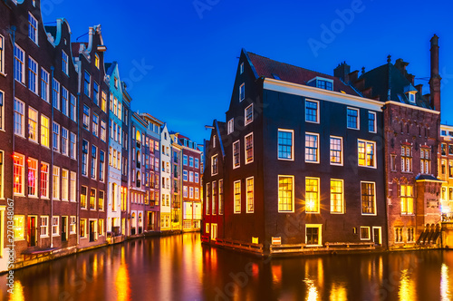 Photo Stands Amsterdam Typical old dutch houses over canal with reflections at twilight in Amsterdam, North Hilland, Netherlands. Amsterdam postcard.