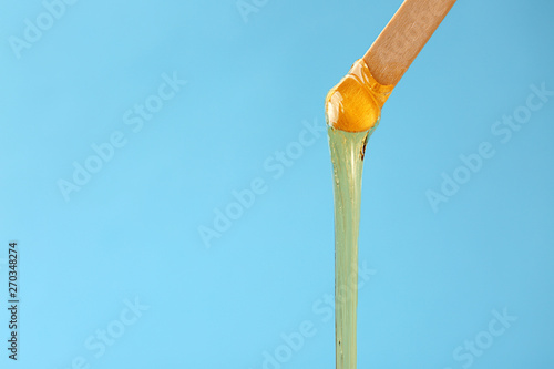 Fotografia  Stick with sugaring paste on color background
