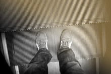 Standing On Escalator.