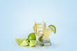 Leinwanddruck Bild - Shots of tequila with splashes on light background