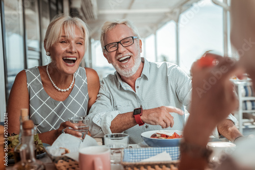 Handsome bearded senior man laughing at joke