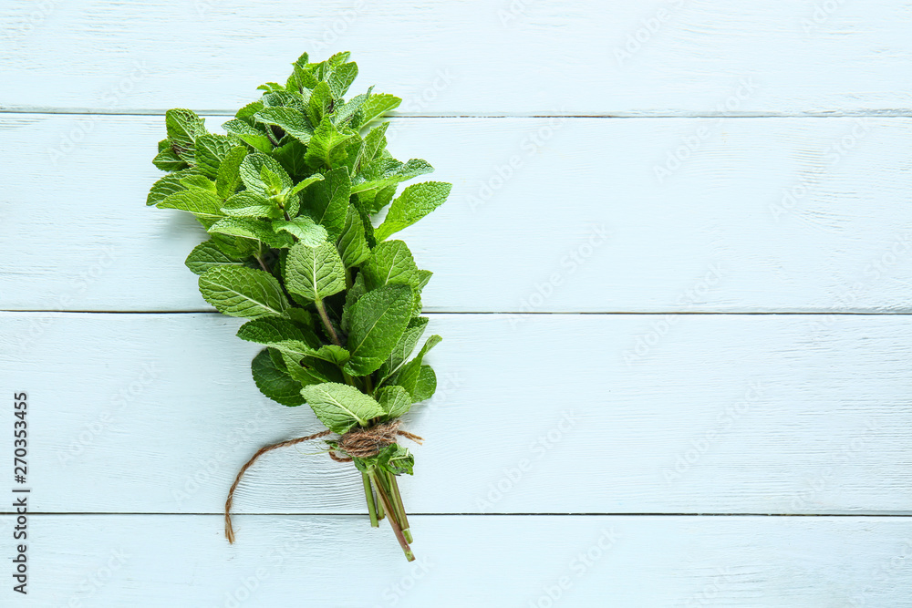 Fototapety, obrazy: Bunch of fresh mint on white wooden background