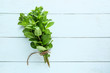 Bunch of fresh mint on white wooden background