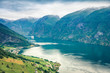 Bird's-eye view of Sognefjorden fjord. Colorful summer scene with Aurlandsvangen village, Norway. Traveling concept background. Instagram filter toned.