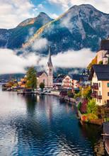 Sunny Autumn Scene Of Hallstatt Lake. Splendid Morning Viev Of Hallstatt Village, In Austria's Mountainous Salzkammergut Region, Austria. Beauty Of Countryside Concept Background.