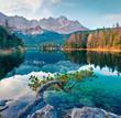 Leinwandbild Motiv Splendid morning scene of Eibsee lake with Zugspitze mountain range on background. Colorful autumn view of Bavarian Alps, Germany, Europe. Beauty of nature concept background.