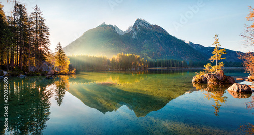 Foto auf Leinwand Wasserfalle Fantastic autumn sunrise on Hintersee lake. Colorful morning view of Bavarian Alps on the Austrian border, Germany, Europe. Beauty of nature concept background.