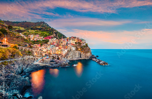 Europe Méditérranéenne Second city of the Cique Terre sequence of hill cities - Manarola. Colorful spring sunset in Liguria, Italy, Europe. Picturesqie seascape of Mediterranean sea. Traveling concept background.