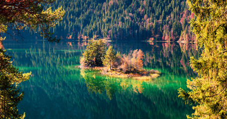 Fototapeta Rzeki i Jeziora Bright autumn panorama of Eibsee lake. Sunny morning view of small island on bottom of the Zugspitze peak, Bavaria, Germany, Europe. Beauty of nature concept background.