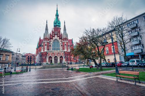 Fototapeta Dramatic autumn view of Parish of St. Joseph church. Rainy morning cityscape of Krakow, Poland, Europe. Traveling concept background. obraz