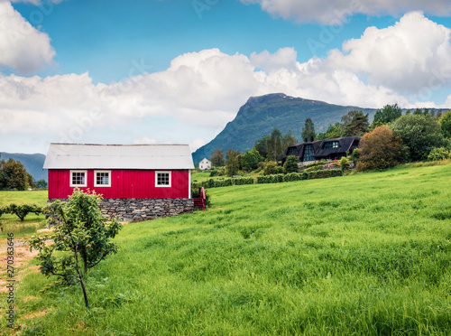 Foto auf AluDibond Pistazie Typical countryside Norwegian landscape with red painted wall house. Picturesque summer morning in Norway, Europe. Beauty of nature concept background. Artistic style post processed photo.