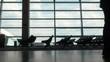 Travellers walking across an airport hallway.