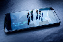 Miniature People, Businessmen In Meeting On The Screen Of A Mobile Phone