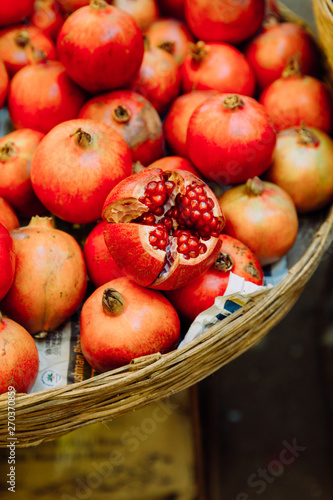 Fruits a basket full of pomegranates standing on Goa market