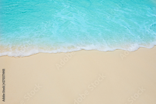 Foto auf Leinwand Turkis Soft waves of blue sea on the Maldives beach for the background.