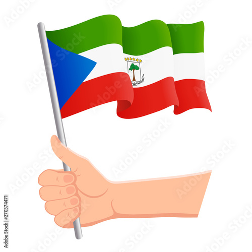 Hand Holding And Waving The National Flag Of Equatorial